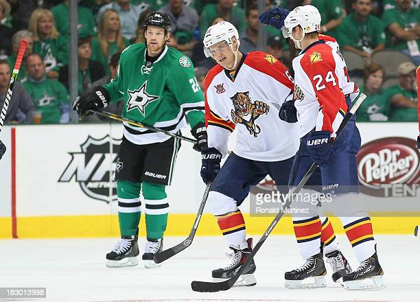 Aleksander Barkov of the Florida Panthers and Brad Boyes against the Dallas Stars at American Airlines Center on October 3 2013 in Dallas Texas
