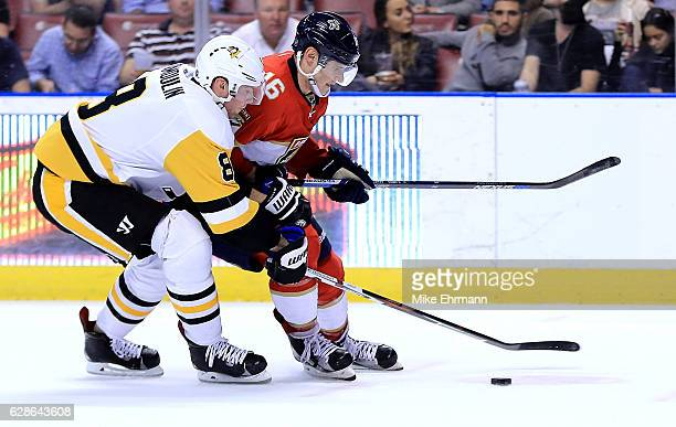Aleksander Barkov of the Florida Panthers and Brian Dumoulin of the Pittsburgh Penguins fight for the puck during a game at BBT Center on December 8...