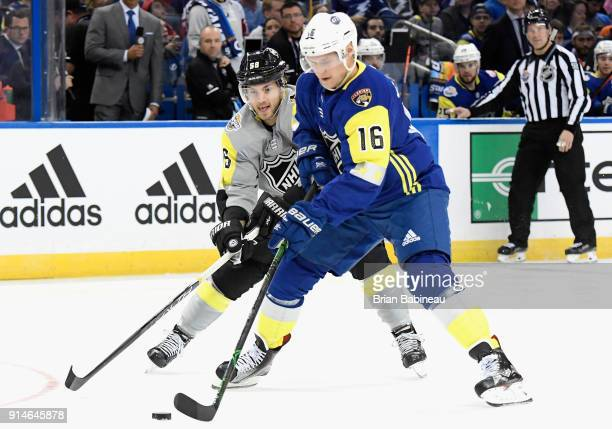 Aleksander Barkov of the Florida Panthers and Kris Letang of the Pittsburgh Penguins play in the 2018 Honda NHL AllStar Game between the Atlantic...