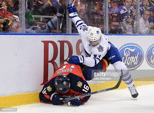 Aleksander Barkov of the Florida Panthers and Nazem Kadri of the Toronto Maple Leafs collided during a game at BBT Center on January 26 2016 in...