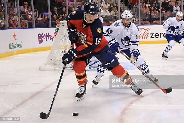 Aleksander Barkov of the Florida Panthers and Nazem Kadri of the Toronto Maple Leafs fight for the puck during a game at BBT Center on January 26...
