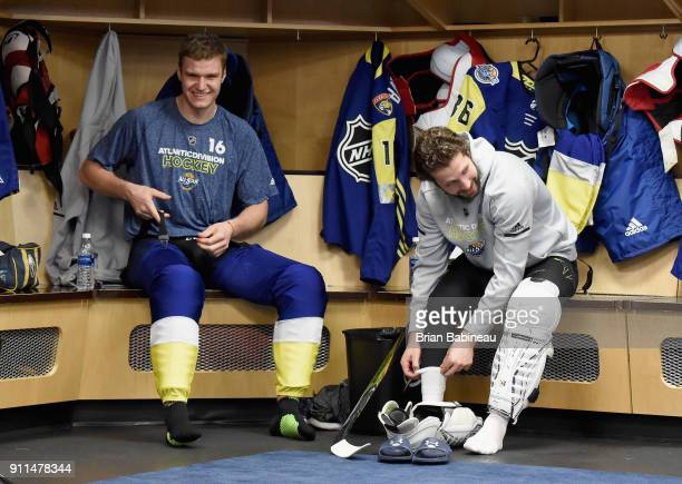 Aleksander Barkov of the Florida Panthers and Nikita Kucherov of the Tampa Bay Lightning sit in their locker room stalls prior to the 2018 Honda NHL...