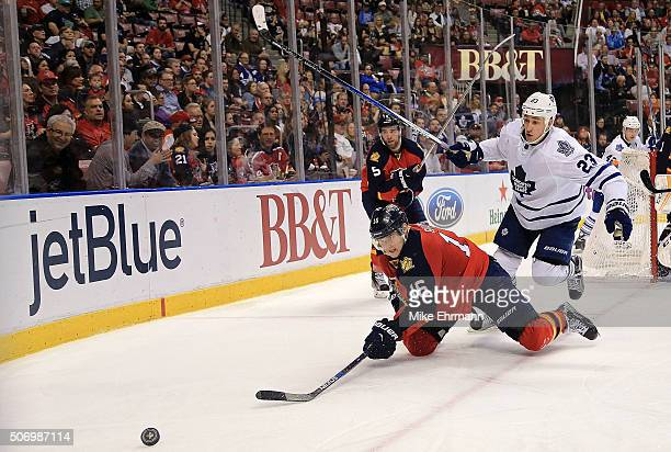 Aleksander Barkov of the Florida Panthers and Shawn Matthias of the Toronto Maple Leafs fight for the puck during a game at BBT Center on January 26...