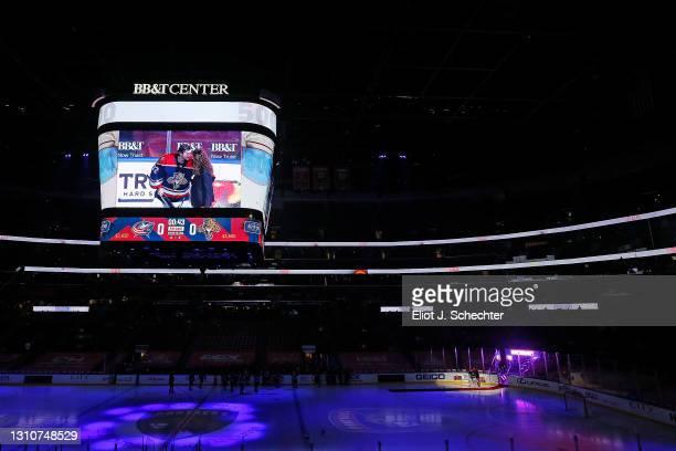 Aleksander Barkov of the Florida Panthers and teammates Goaltender Chris Driedger, Patric Hornqvist present teammate Goaltender Sergei Bobrovsky a...