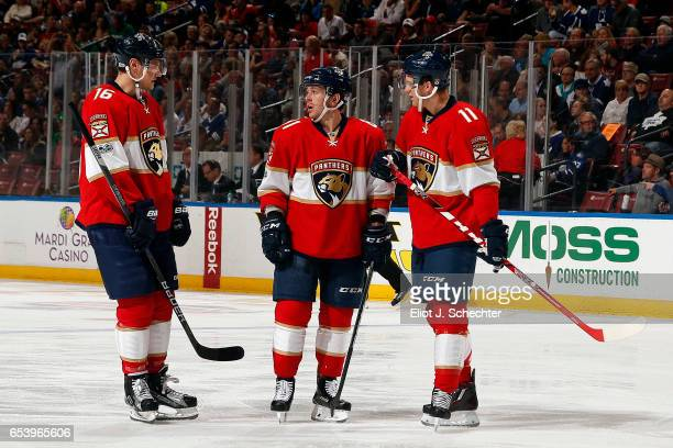 Aleksander Barkov of the Florida Panthers and teammates Jonathan Marchessault Jonathan Huberdeau chat during a break in the action against the...