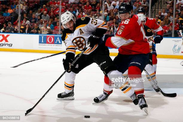Aleksander Barkov of the Florida Panthers battles for possession of the puck against Patrice Bergeron of the Boston Bruins at the BBT Center on April...