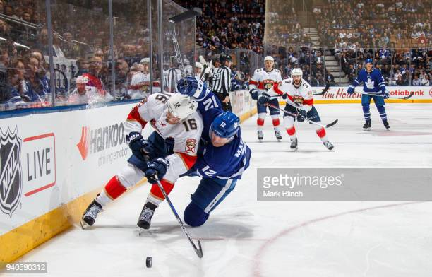 Aleksander Barkov of the Florida Panthers battles with Patrick Marleau of the Toronto Maple Leafs during the third period at the Air Canada Centre on...