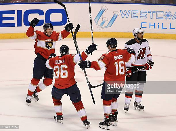 Aleksander Barkov of the Florida Panthers celebrates a game winning goal during Opening Night of the 20162017 NHL Season against New Jersey Devils at...