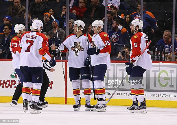 Aleksander Barkov of the Florida Panthers celebrates a goal with teamates against the New York Islanders during their game at the Barclays Center on...