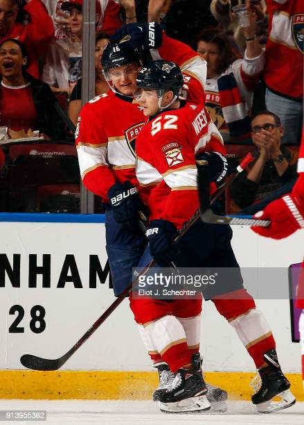 Aleksander Barkov of the Florida Panthers celebrates his goal with teammate MacKenzie Weegar during the second period against the Detroit Red Wings...