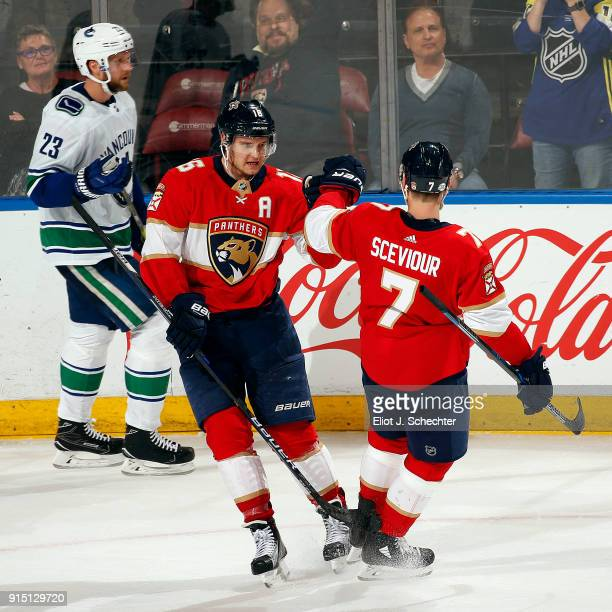 Aleksander Barkov of the Florida Panthers celebrates his second goal of the game with teammate Colton Sceviour against the Vancouver Canucks at the...