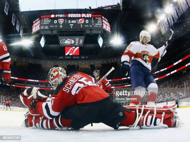 Aleksander Barkov of the Florida Panthers celebrates his shorthanded goal at 1720 of the second period against Cory Schneider of the New Jersey...