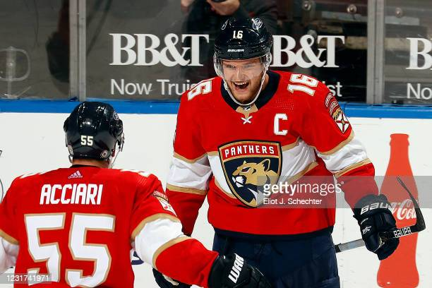 Aleksander Barkov of the Florida Panthers celebrates his third period goal with teammate Noel Acciari against the Chicago Blackhawks at the BB&T...
