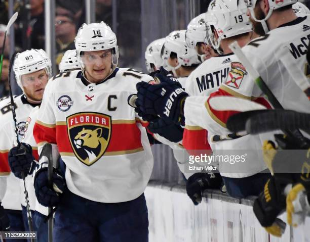 Aleksander Barkov of the Florida Panthers celebrates with teammates on the bench after scoring a secondperiod goal against the Vegas Golden Knights...