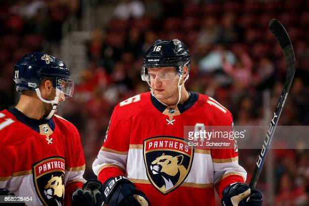 Aleksander Barkov of the Florida Panthers chats with teammate Vincent Trocheck during a break in the action against the Detroit Red Wings at the BBT...