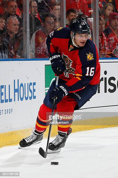 Aleksander Barkov of the Florida Panthers circles the net with the puck during first period action against the New York Islanders in Game Five of the...