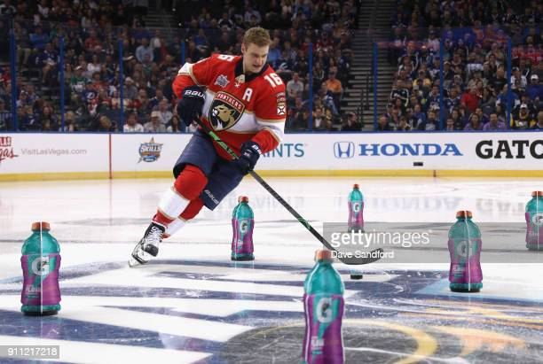 Aleksander Barkov of the Florida Panthers competes in the Gatorade NHL Puck Control Relay during 2018 GEICO NHL AllStar Skills Competition at Amalie...