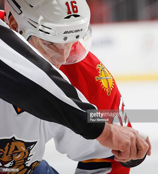 Aleksander Barkov of the Florida Panthers concentrates on the puck as he awaits a faceoff in an NHL hockey game against the New Jersey Devils at...