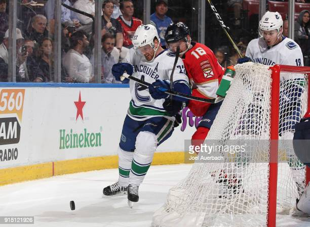 Aleksander Barkov of the Florida Panthers defends against Daniel Sedin of the Vancouver Canucks as he circles behind the net with the puck during...