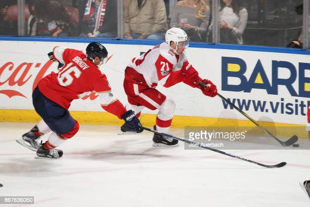 Aleksander Barkov of the Florida Panthers defends against Dylan Larkin of the Detroit Red Wings during third period action at the BBT Center on...