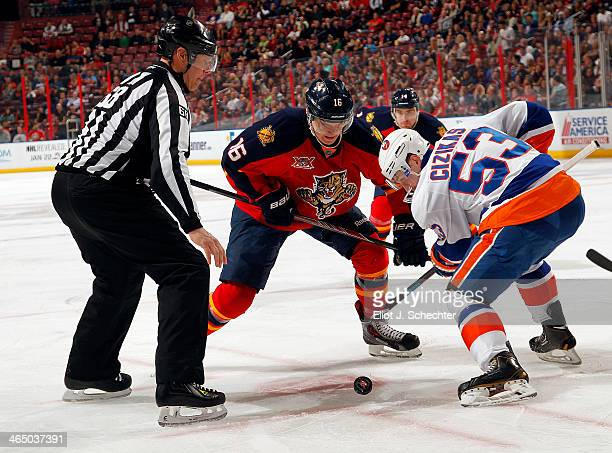 Aleksander Barkov of the Florida Panthers faces off against Casey Cizikas of the New York Islanders at the BBT Center on January 14 2014 in Sunrise...