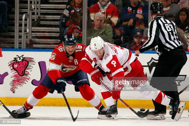Aleksander Barkov of the Florida Panthers faces off against Justin Abdelkader of the Detroit Red Wings at the BBT Center on February 3 2018 in...