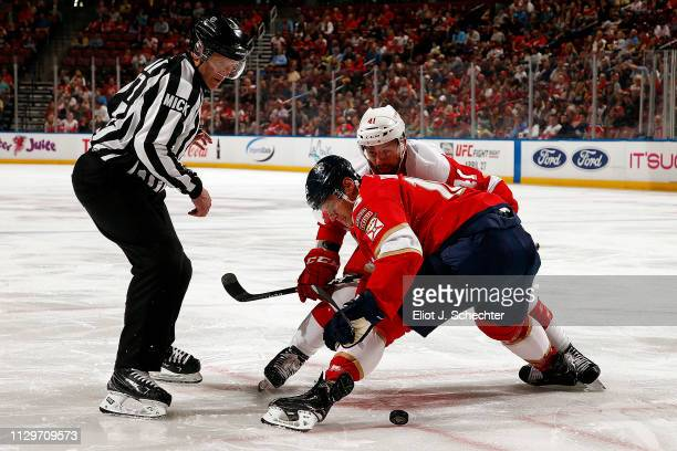 Aleksander Barkov of the Florida Panthers faces off against Luke Glendening of the Detroit Red wings at the BBT Center on March 10 2019 in Sunrise...