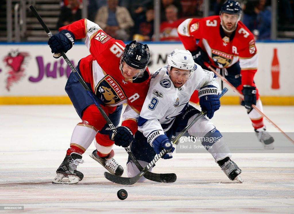 Aleksander Barkov #16 of the Florida Panthers faces off against Tyler Johnson #9 of the Tampa Bay Lightning at the BB&T Center on October 30, 2017 in Sunrise, Florida.