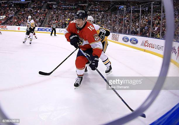 Aleksander Barkov of the Florida Panthers fights for the puck during a game against the Pittsburgh Penguins at BBT Center on December 8 2016 in...