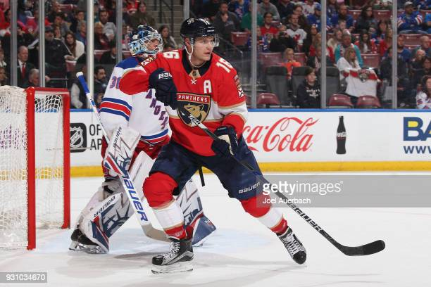 Aleksander Barkov of the Florida Panthers gets into position for a tip in attempt in front of Goaltender Henrik Lundqvist of the New York Rangers at...