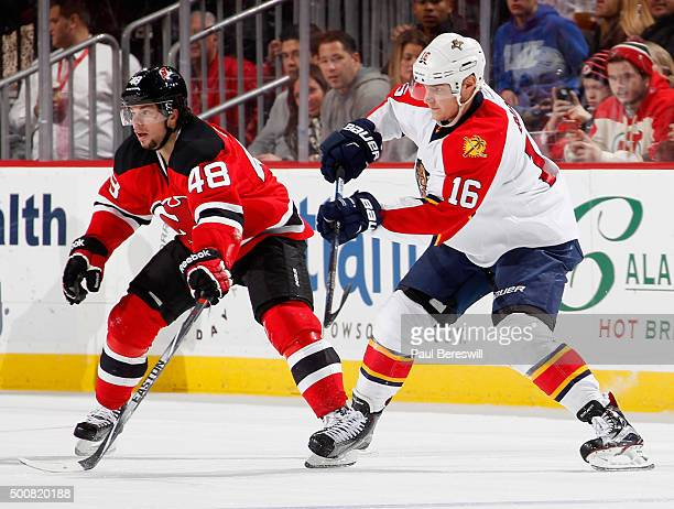 Aleksander Barkov of the Florida Panthers gets off a pass in front of Tyler Kennedy of the New Jersey Devils in an NHL hockey game at Prudential...