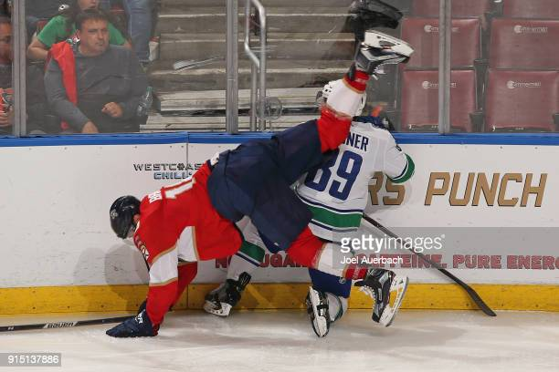 Aleksander Barkov of the Florida Panthers goes to the ice after colliding with Sam Gagner of the Vancouver Canucks during thirdperiod action at the...