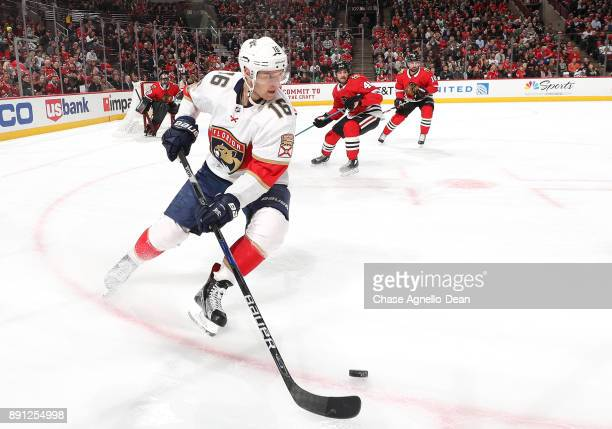 Aleksander Barkov of the Florida Panthers grabs the puck in the first period against the Chicago Blackhawks at the United Center on December 12 2017...