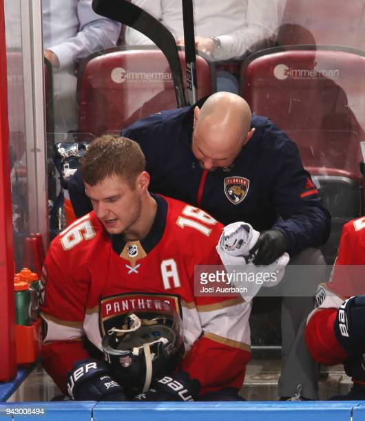 Aleksander Barkov of the Florida Panthers is checked by a staff member after being injured during third period action against the Boston Bruins at...
