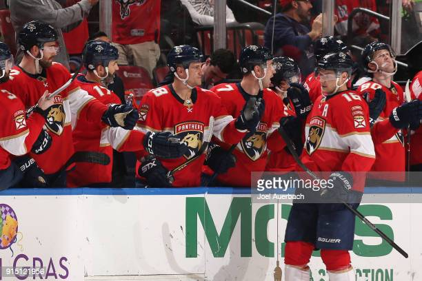 Aleksander Barkov of the Florida Panthers is congratulated by teammates after scoring a second period goal against the Vancouver Canucks at the BBT...