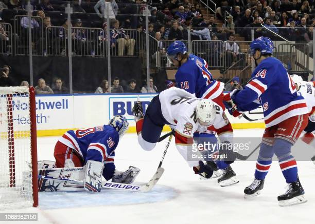 Aleksander Barkov of the Florida Panthers is tripped up in front of the New York Rangers net during the first period at Madison Square Garden on...