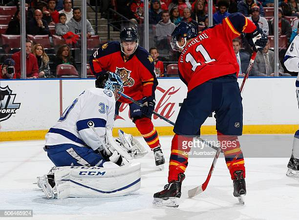 Aleksander Barkov of the Florida Panthers looks on as goaltender Ben Bishop of the Tampa Bay Lightning stops a shot by Jonathan Huberdeau during...