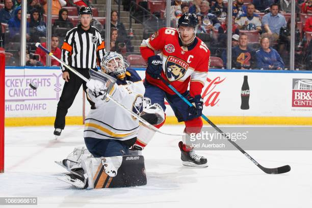 Aleksander Barkov of the Florida Panthers looks on as Goaltender Linus Ullmark of the Buffalo Sabres deflect a shot during first period action at the...