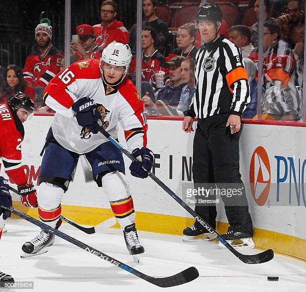 Aleksander Barkov of the Florida Panthers looks to pass in an NHL hockey game against the New Jersey Devils at Prudential Center on December 6 2015...