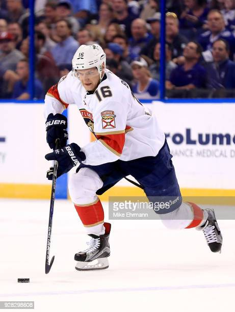 Aleksander Barkov of the Florida Panthers passes during a game against the Tampa Bay Lightning at Amalie Arena on March 6 2018 in Tampa Florida