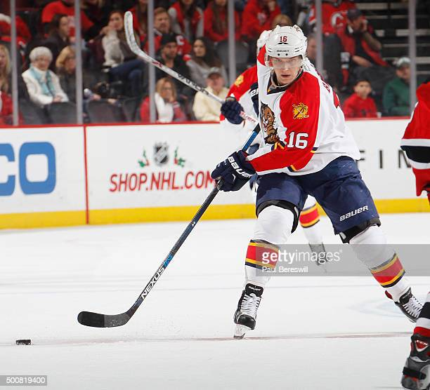 Aleksander Barkov of the Florida Panthers passes in an NHL hockey game against the New Jersey Devils at Prudential Center on December 6 2015 in...