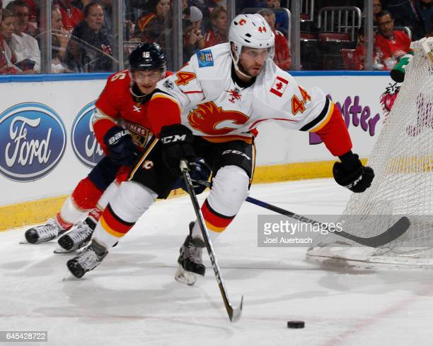 Aleksander Barkov of the Florida Panthers pursues Matt Bartkowski of the Calgary Flames as he clears the puck from behind the net at the BBT Center...