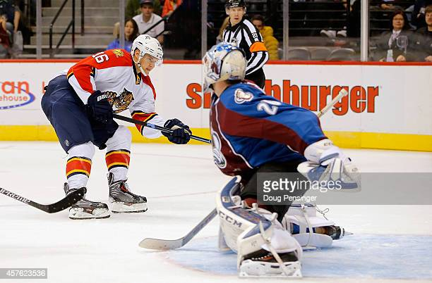 Aleksander Barkov of the Florida Panthers puts a shot past goalie Reto Berra of the Colorado Avalanche for a goal to take a 20 lead in the second...