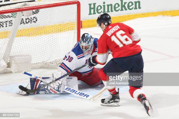 Aleksander Barkov of the Florida Panthers scores a shootout goal against goaltender Henrik Lundqvist of the New York Rangers at the BBT Center on...