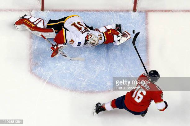 Aleksander Barkov of the Florida Panthers scores in a shoot out against Goaltender Mike Smith of the Calgary Flames at the BBT Center on February 14...