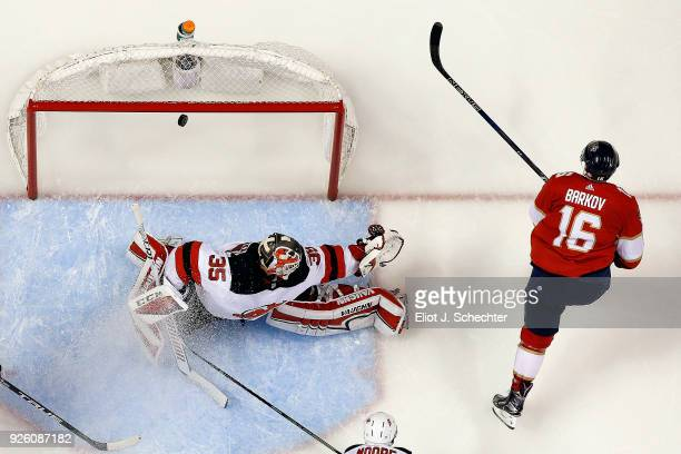 Aleksander Barkov of the Florida Panthers scores the game winning goal against Goaltender Cory Schneider of the New Jersey Devils at the BBT Center...