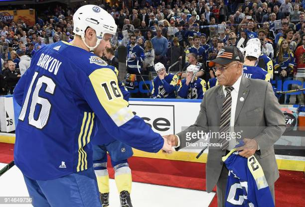 Aleksander Barkov of the Florida Panthers shakes the hand of former NHL player Willie O'Ree in between periods of the 2018 Honda NHL AllStar Game...