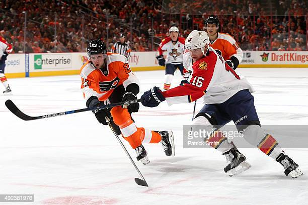 Aleksander Barkov of the Florida Panthers shoots in front of Brandon Manning of the Philadelphia Flyers in the first period at Wells Fargo Center on...