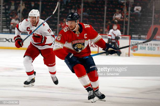 Aleksander Barkov of the Florida Panthers skates for position against Jordan Staal of the Carolina Hurricanes at the BB&T Center on April 24, 2021 in...