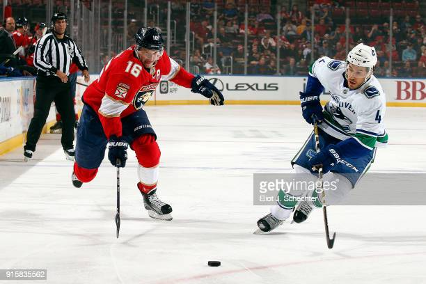 Aleksander Barkov of the Florida Panthers skates for possession against Michael Del Zotto of the Vancouver Canucks at the BBT Center on February 6...